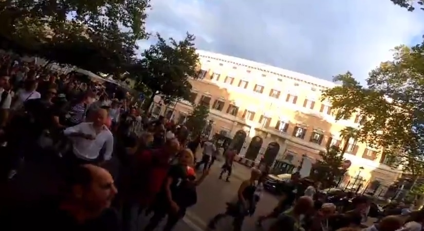 In front of the US Embassy in Rome, they are chanting FJB